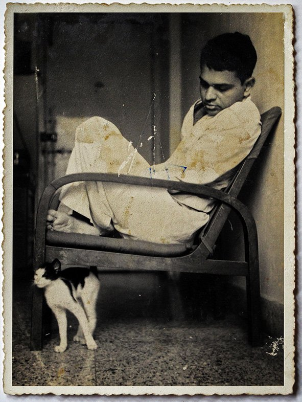 My father Subir Chaudhuri with a cat. Bombay. Circa 1968